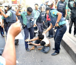 police beating protestor